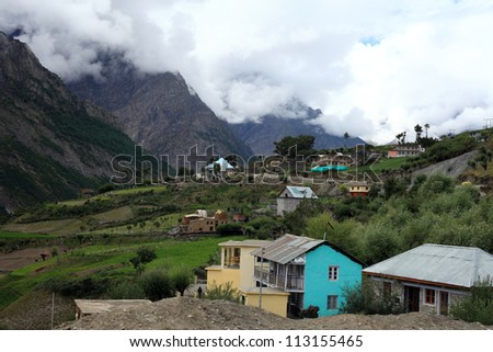 A village at the down hill of the Himalayas - stock photo