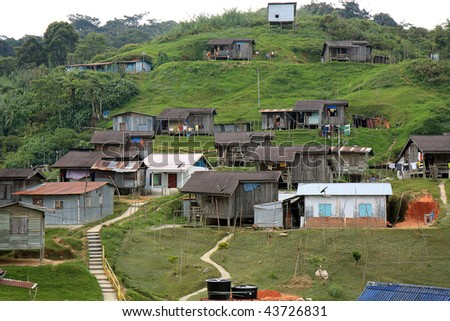 A village of one of the native people of Malaysia at Cameron Highlands; equipped with modern amenities such as electricity and satelite television. - stock photo