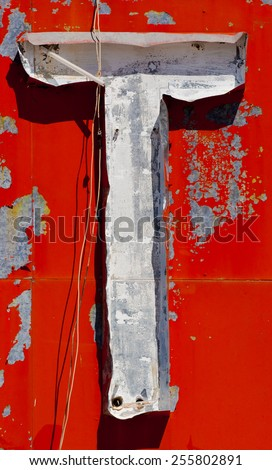 """A vintage, antique, old letter """"T"""" on a sign - stock photo"""