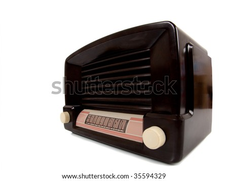 A vintage antique radio on a white background with copy space - stock photo