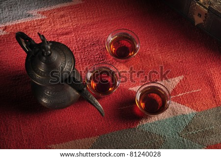 A vintage arabic coffee kettle and tea - stock photo
