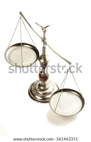 A vintage balance scale. - stock photo