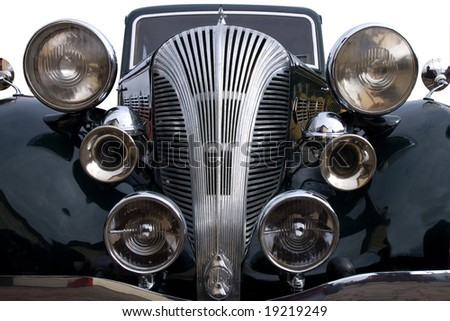 A vintage black car with lights and chrome horn - stock photo
