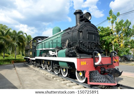 a vintage black steam powered railway train from thailand - stock photo