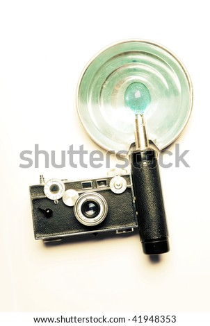 A vintage camera with flash, cross-processed - stock photo