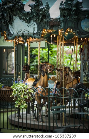 a vintage carousel in a city park - stock photo