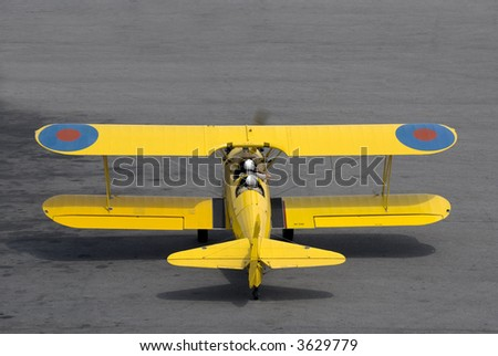 A vintage (circa 1942) Boeing Stearman PT-27 Kaydet trainer prepares for takeoff. - stock photo