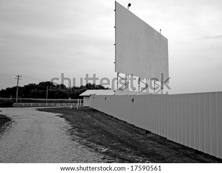 A vintage drive-in movie theater in black and white. - stock photo