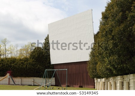 A vintage drive in movie theater screen and lot. - stock photo