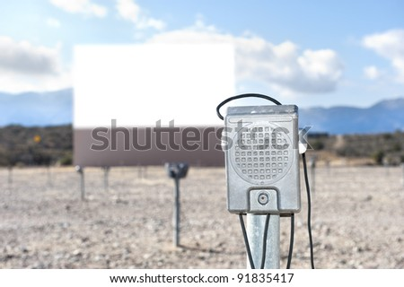 A vintage drive in theater with a close up of the window-mounted speaker. - stock photo