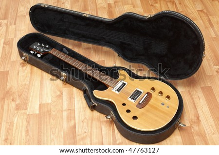 A vintage electric guitar in its case. - stock photo