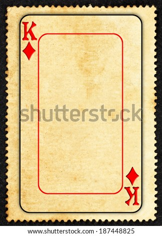 A vintage King of Diamond symbol gaming card on a grungy retro paper parchment with blank space for text. - stock photo