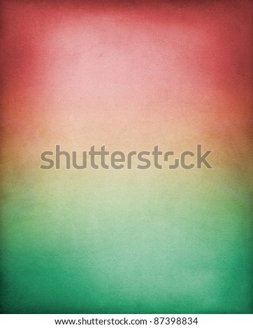 A vintage paper background with a red to green gradient.  Image has a pleasing grain and texture at 100%. - stock photo