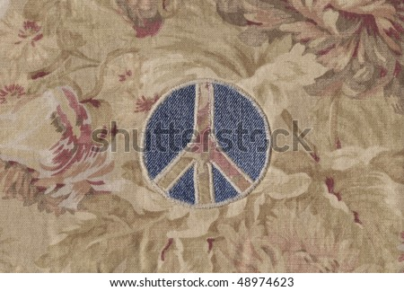 A vintage peace sign sewn out of fabric