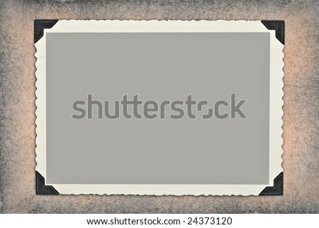 A vintage photo on a textured grey and tan background. - stock photo
