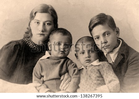 A vintage photo portrait from 1916 of Russian family. - stock photo