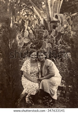 A vintage photo portrait from 1935 of two Russian women.