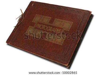 a vintage photographs album on white