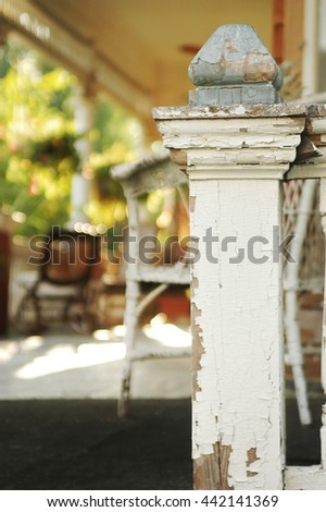 A vintage porch of an old house.                    - stock photo