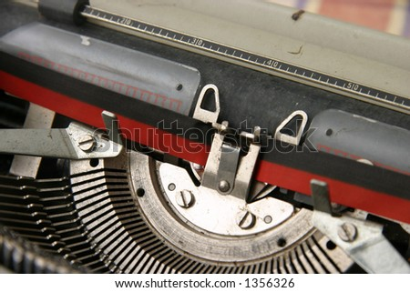A vintage portable typewriter with ink ribbon - stock photo