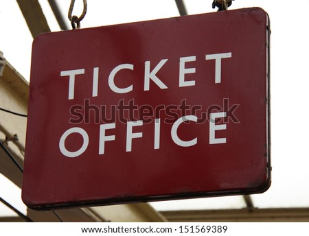 A Vintage Railway Station Ticket Office Sign. - stock photo