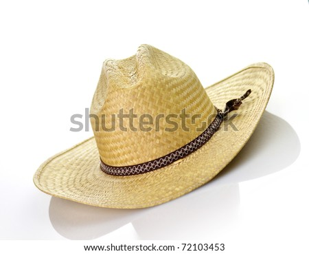a vintage straw hat on white background - stock photo