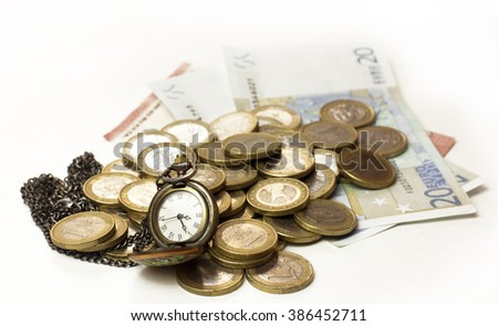 A vintage style chain watch with a heap of euro money in coins and banknotes, on white background - stock photo