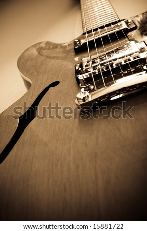 A vintage style electro acoustic guitar - stock photo