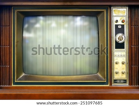 A vintage television set from about sixty years ago with bad picture quality  - stock photo