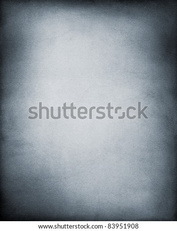 A vintage, textured paper background in cool black and white tones. - stock photo