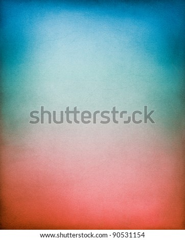A vintage, textured paper background with a red to blue toned gradient. - stock photo