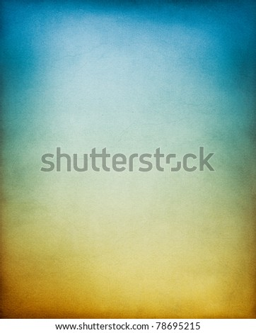 A vintage, textured paper background with an earth to sky toned gradient. - stock photo