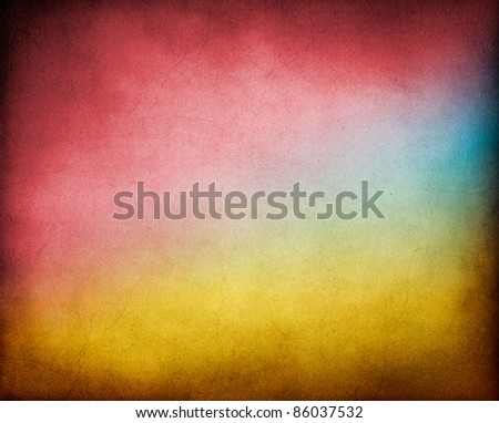 A vintage, textured paper background with multicolored gradients.  Image has a pleasing paper texture and grain at 100%. - stock photo
