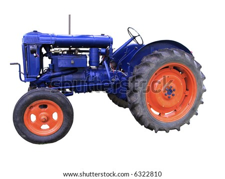 A vintage Tractor isolated with clipping path - stock photo