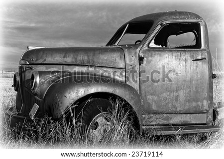 A vintage truck in the field - stock photo