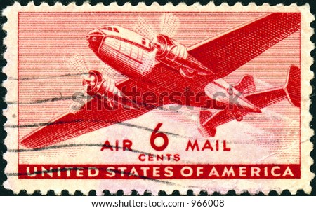 A vintage US Air Mail Stamp with an airplane, six cents. - stock photo