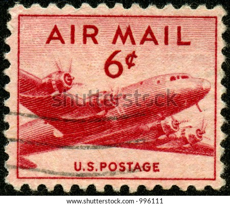 A vintage US Airmail Stamp with airplane. Six Cents. - stock photo