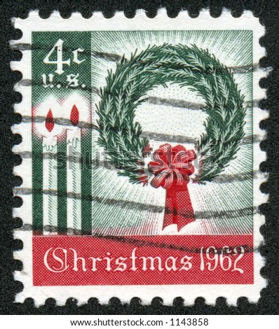 A vintage US Postage Stamp depicting a wreath and candles from 1962, Four Cents. - stock photo