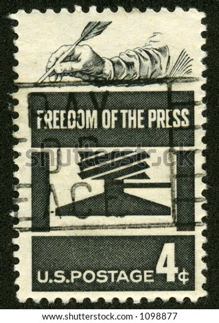A vintage US Postage stamp depicting the Freedom of the press. - stock photo