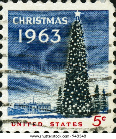 A vintage US potage stamp from 1963 with a christmas tree and white house in the background. - stock photo