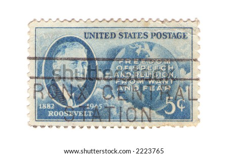 "A vintage Us stamp commemorating Us president Roosevelt with quote ""Freedom of speech and religion, from want and fear"""