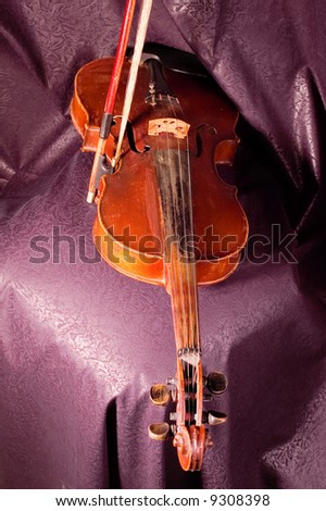 A vintage violin instrument on dark background