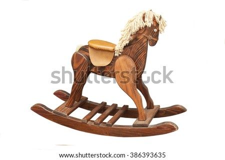 A Vintage Wooden Rocking Horse isolated on a white background
