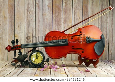 A violin and a watch still life, selective focus.