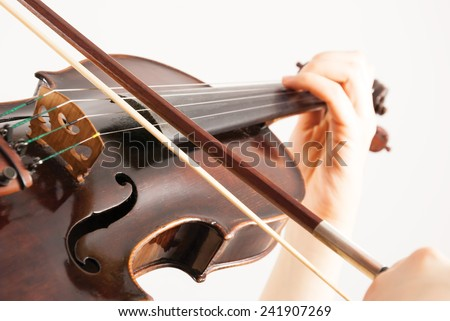 A violinist plays a violin or fiddle - stock photo