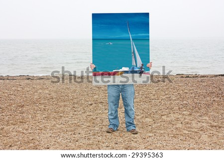 A visual composite of a man holding a photo on a beach, all horizons are carefully matched - stock photo