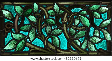 A vivid panel of lush leaves with twining stems in a stained glass window. From St. Paul's Church (1749), Halifax, Nova Scotia. - stock photo