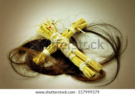 A Voodoo doll and long hair - stock photo