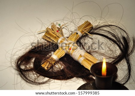 A Voodoo doll and long hair , Halloween  - stock photo