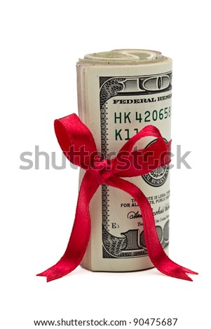 A wad of US one hundred dollar bills wrapped in a red ribbon with a gift bow attached. - stock photo
